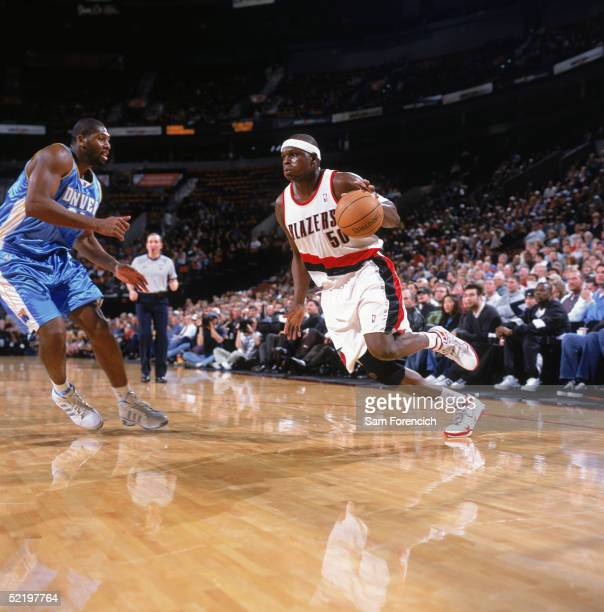 Zach Randolph of the Portland Trail Blazers drives during the game against the Denver Nuggets at The Rose Garden on February 2 2005 in Portland...