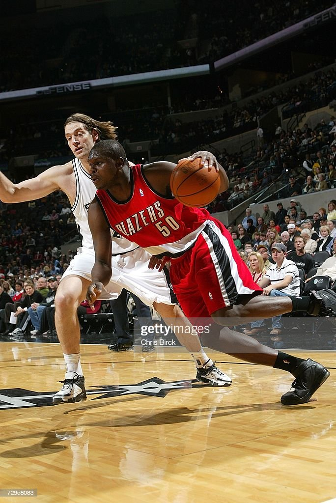 Zach Randolph #50 of the Portland Trail Blazers drives past Fabricio Oberto #7 of the San Antonio Spurs on January 9, 2007 at the AT&T Center in San Antonio, Texas.