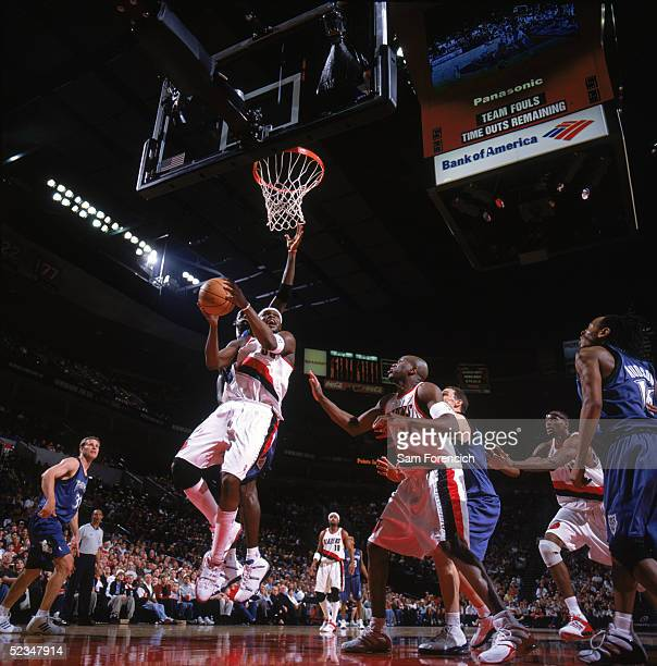 Zach Randolph of the Portland Trail Blazers drives to the basket past Kevin Garnett of the Minnesota Timberwolves during a game at The Rose Garden on...