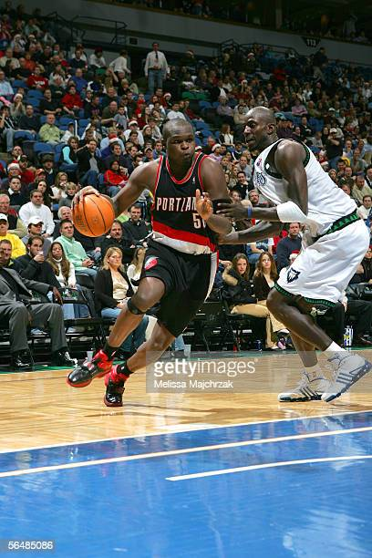 Zach Randolph of the Portland Trail Blazers drives to the basket around Kevin Garnett of the Minnesota Timberwolves on December 23 2005 at the Target...