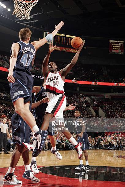 Zach Randolph of the Portland Trail Blazers drives to the basket against Andrei Kirilenko of the Utah Jazz during a preseason game at the Rose Garden...