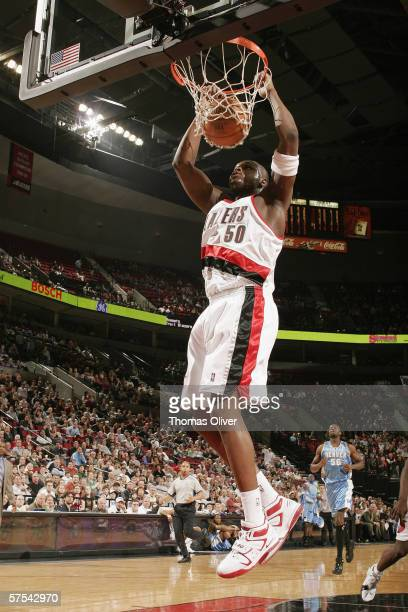 Zach Randolph of the Portland Trail Blazers dunks against the Denver Nuggets at the Rose Garden on April 10 2006 in Portland Oregon The Nuggets won...