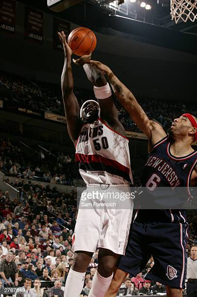 Zach Randolph of the Portland Trail Blazers gets fouled by Kenyon Martin of the New Jersey Nets while taking a shot on November 28 2003 at the Rose...