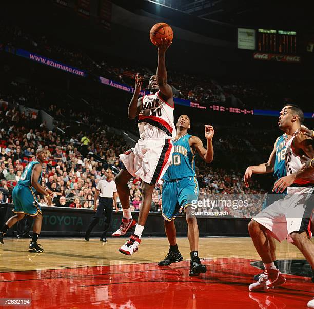 Zach Randolph of the Portland Trail Blazers goes for a layup past David West of the New Orleans/Oklahoma City Hornets during a game at The Rose...