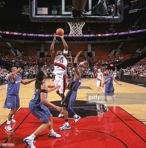 Zach Randolph of the Portland Trail Blazers goes for the basket under pressure from Antawn Jamison and Etan Thomas of the Washingtons Wizards at The...