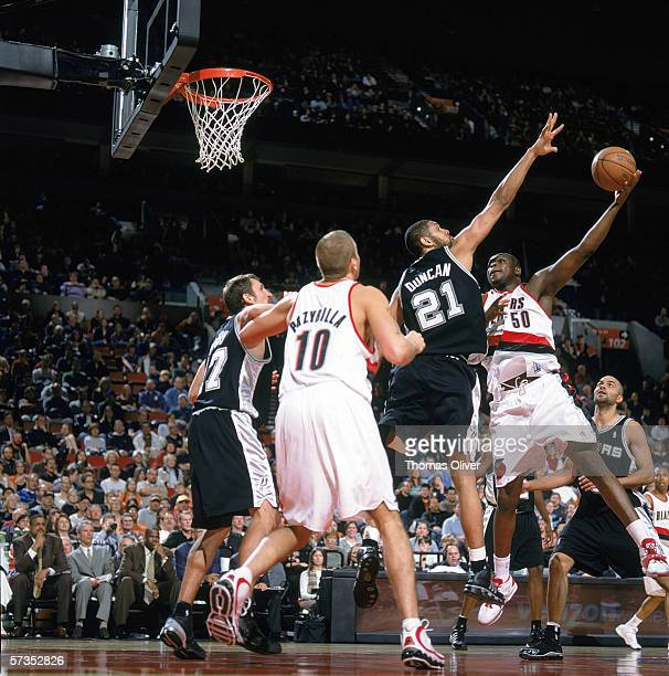 Zach Randolph of the Portland Trail Blazers goes for the basket under pressure from Tim Duncan of the San Antonio Spurs at The Rose Garden on March...