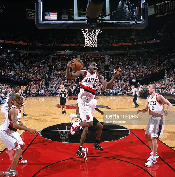 Zach Randolph of the Portland Trail Blazers goes for the basket under pressure from the San Antonio Spurs at The Rose Garden on March 24 2006 in...