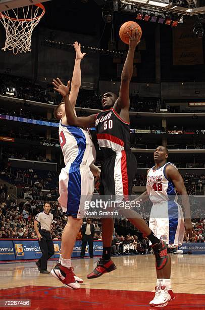 Zach Randolph of the Portland Trail Blazers goes strong to the hoop against Paul Davis and Elton Brand of the Los Angeles Clippers on October 25 2006...