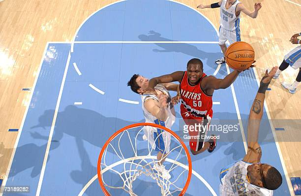 Zach Randolph of the Portland Trail Blazers goes to the basket against Eduardo Najera and Marcus Camby of the Denver Nuggets at the Pepsi Center...