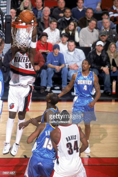 Zach Randolph of the Portland Trail Blazers goes to the basket during the game against the Denver Nuggets at The Rose Garden on January 2 2004 in...
