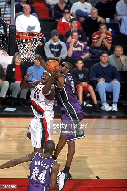 Zach Randolph of the Portland Trail Blazers goes to the basket against Joe Smith of the Milwaukee Bucks during the NBA game at The Rose Garden on...