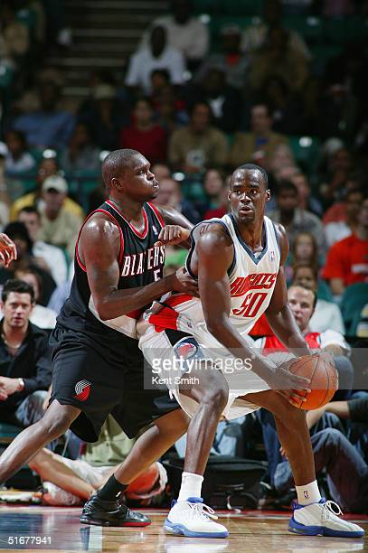 Zach Randolph of the Portland Trail Blazers guards Emeka Okafor of the Charlotte Bobcats during the game on October 22 2004 in Charlotte North...
