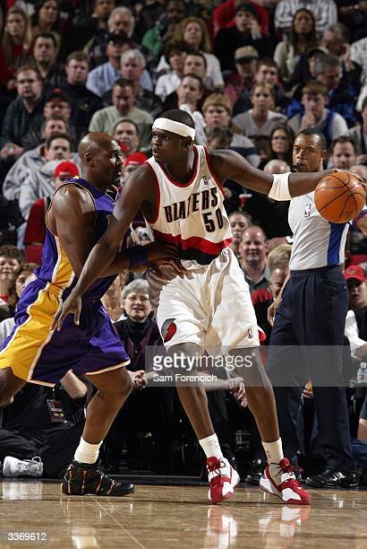 Zach Randolph of the Portland Trail Blazers is defended by Kobe Bryant of the Los Angeles Lakers during a game on April 14, 2004 at the Rose Garden...