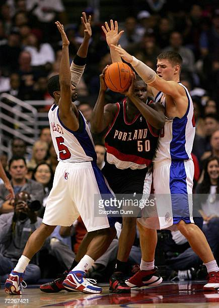 Zach Randolph of the Portland Trail Blazers is trapped between Cuttino Mobley and Paul Davis of the Los Angeles Clippers on October 25 2006 at...