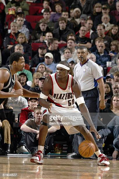 Zach Randolph of the Portland Trail Blazers posts up Robert Horry of the San Antonio Spurs on December 30 2004 at the Rose Garden Arena in Portland...