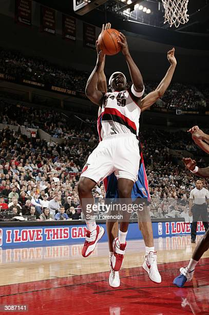 Zach Randolph of the Portland Trail Blazers puts up a shot from under the basket against a Detroit Pistons defender during the game at the Rose...