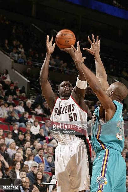 Zach Randolph of the Portland Trail Blazers reaches for the ball against David West of the New Orleans/Oklahoma City Hornets February 26 2006 at the...