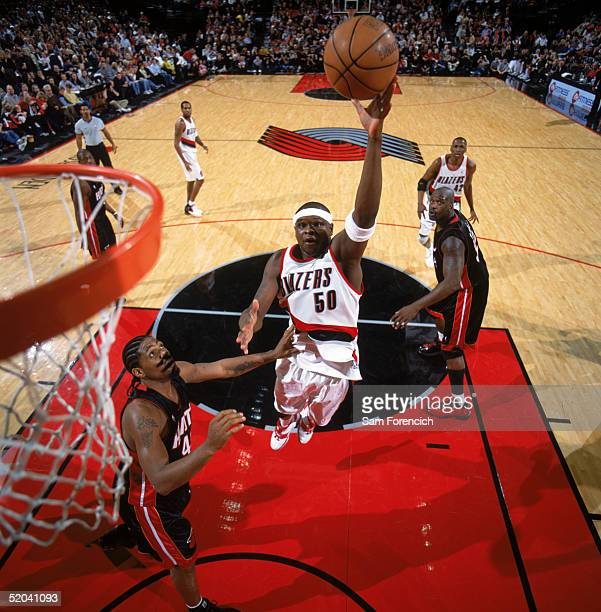 Zach Randolph of the Portland Trail Blazers shoots a layup over Udonis Haslem of the Miami Heat during a game at The Rose Garden on January 7 2005 in...