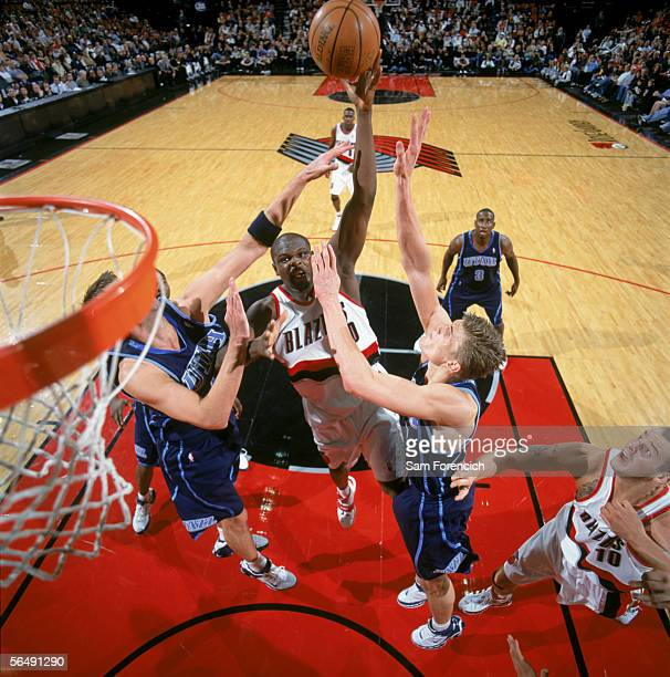 Zach Randolph of the Portland Trail Blazers shoots over Andrei Kirilenko of the Utah Jazz during the game at the Rose Garden Arena in Portland Oregon...