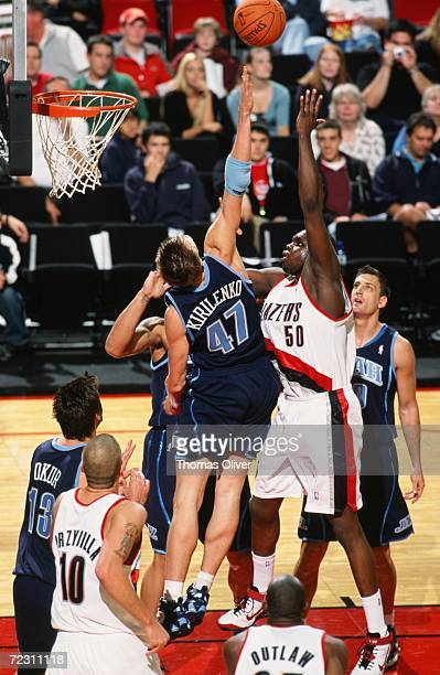 Zach Randolph of the Portland Trail Blazers shoots over Andrei Kirilenko of the Utah Jazz during a preseason game at The Rose Garden on October 23...