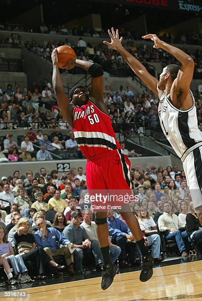 Zach Randolph of the Portland Trail Blazers shoots over Tim Duncan of the San Antonio Spurs during the game at the SBC Center in San Antonio, Texas...