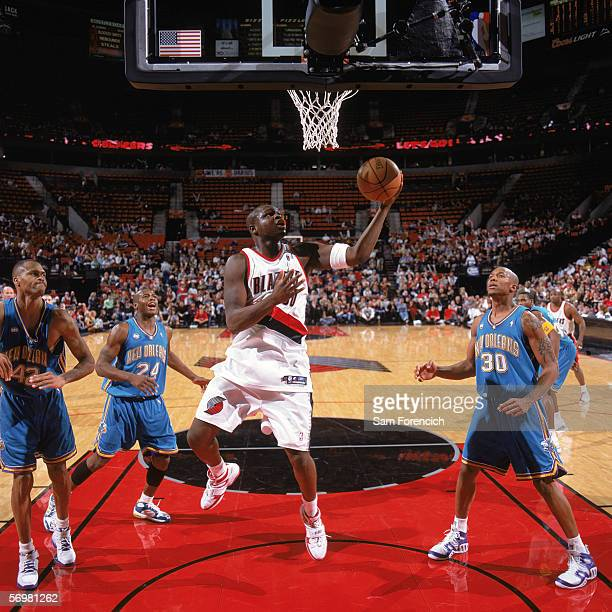 Zach Randolph of the Portland Trail Blazers takes the ball to the basket during a game against the New Orleans/Oklahoma City Hornets at The Rose...