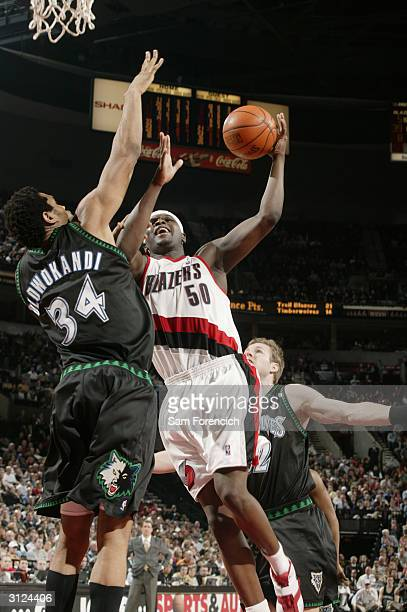 Zach Randolph of the Portland Trail Blazers takes the ball to the basket against Michael Olowokandi of the Minnesota Timberwolves during the game on...