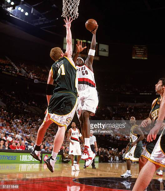 Zach Randolph of the Portland Trail Blazers takes the ball to the basket against Robert Swift of the Seattle Sonics during a preseason game at The...