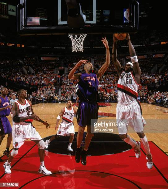 Zach Randolph of the Portland Trail Blazers takes the ball to the basket against Loren Woods of the Toronto Raptors during a game at The Rose Garden...