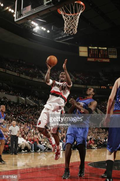 Zach Randolph of the Portland Trail Blazers takes the ball to the basket during the game against the Philadelphia 76ers on December 27 2004 at the...