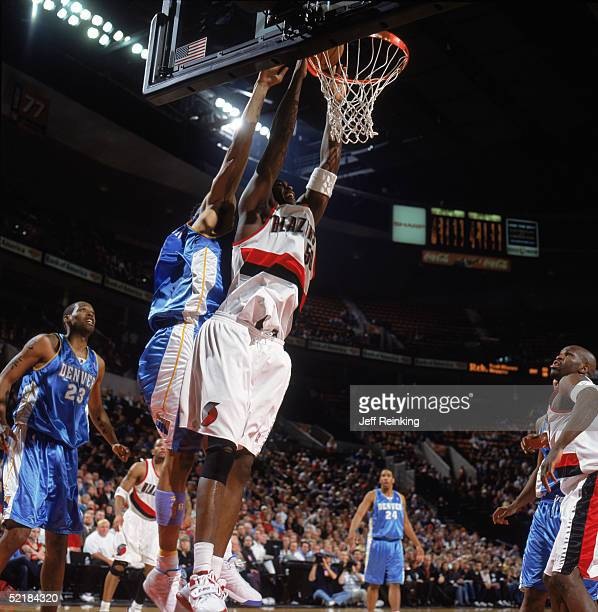 Zach Randolph of the Portland Trail Blazers takes the ball to the basket against Kenyon Martin of the Denver Nuggets during a game at The Rose Garden...