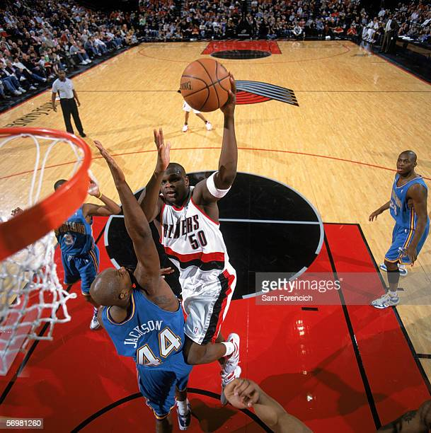 Zach Randolph of the Portland Trail Blazers takes the ball to the basket against Marc Jackson of the New Orleans/Oklahoma City Hornets during a game...
