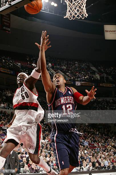 Zach Randolph of the Portland Trail Blazers tries to block a shot by Lucious Harris of the New Jersey Nets during a game on November 28 2003 at the...