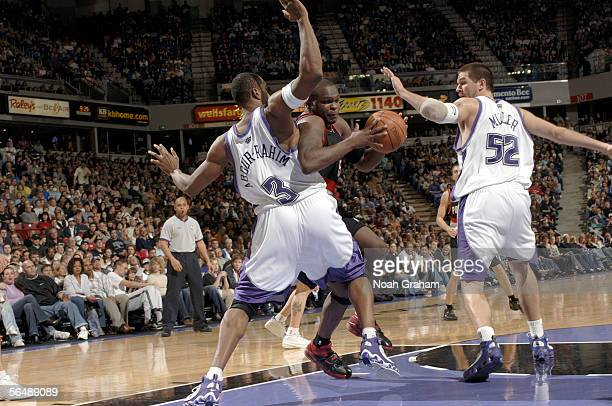 Zach Randolph of the Portland Trailblazers drives to the basket around Shareef AbdurRahim of the Sacramento Kings on December 26 2005 at the ARCO...
