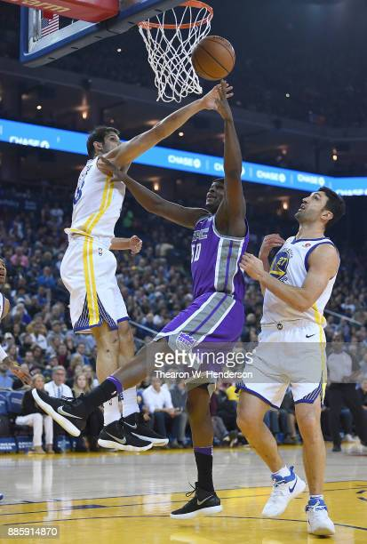 Zach Randolph of the Sacramento Kings shoots over Omri Casspi and Zaza Pachulia of the Golden State Warriors during their NBA basketball game at...