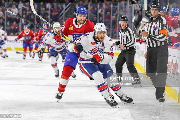 Zach Redmond of the Rochester Americans chasing the puck ahead of Alexandre Grenier of the Laval Rocket at Place Bell on January 5 2019 in Laval...
