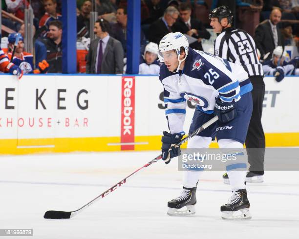 Zach Redmond of the Winnipeg Jets skates against the Edmonton Oilers during a preseason NHL game at Rexall Place on September 23 2013 in Edmonton...