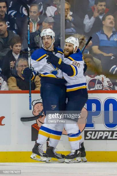 Zach Sanford and Ryan O'Reilly of the St Louis Blues celebrate a third period goal against the Winnipeg Jets at the Bell MTS Place on October 22 2018...