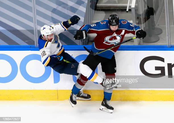 Zach Sanford of the St. Louis Blues and Erik Johnson of the Colorado Avalanche collide during the second period in a Round Robin game during the 2020...