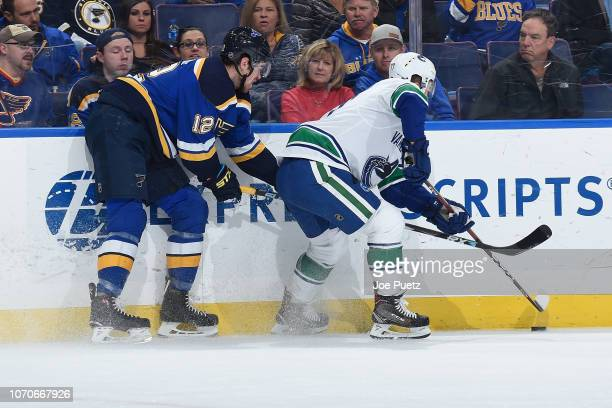 Zach Sanford of the St Louis Blues and Nikolay Goldobin of the Vancouver  Canucks battle for 5ffd76cfd