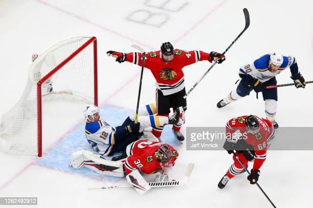 Zach Sanford of the St. Louis Blues falls into Malcolm Subban of the Chicago Blackhawks during the third period in an exhibition game prior to the...