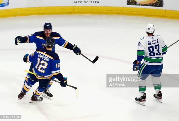 Zach Sanford of the St. Louis Blues scores at 5:51 of the second period against the Vancouver Canucks and is joined by Tyler Bozak in Game Five of...