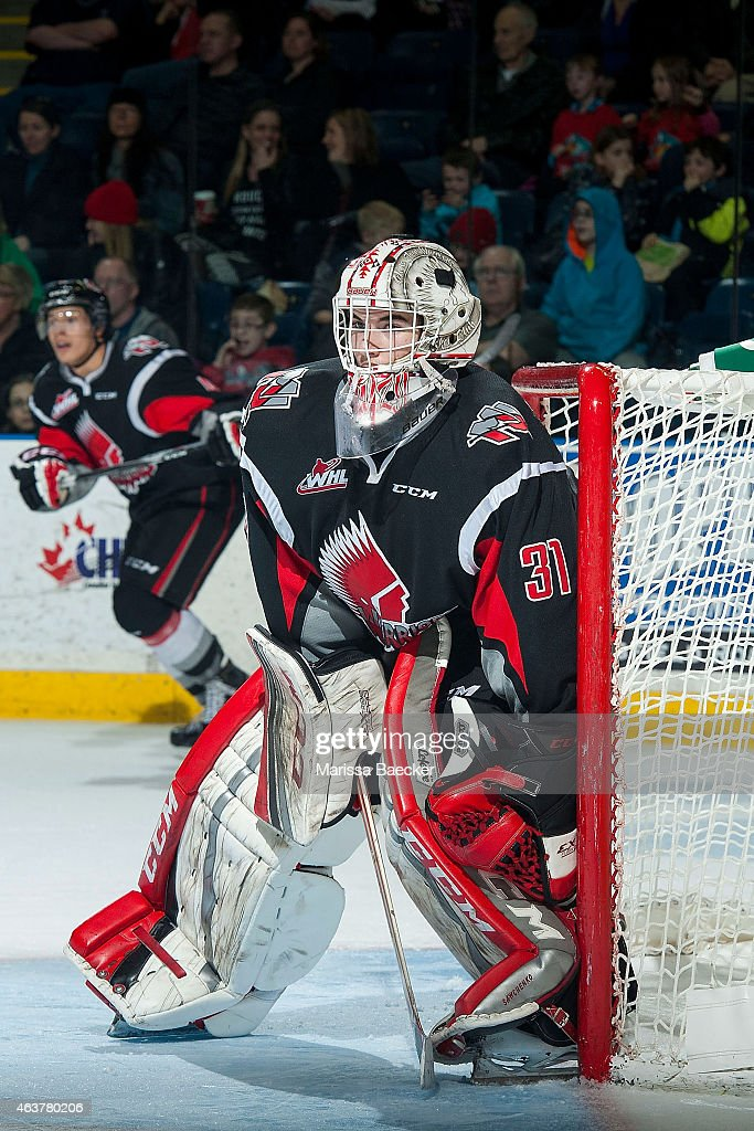 Zach Sawchenko #31 of Moose Jaw Warriors defends the net against the Kelowna Rockets on February 14, 2015 at Prospera Place in Kelowna, British Columbia, Canada.