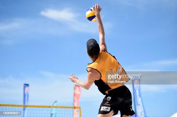 Zach Schubert serves with Max Guehrer in the Men's Final against Chris McHugh and Damien Schumann during the Australian Beach Volleyball Tour at...
