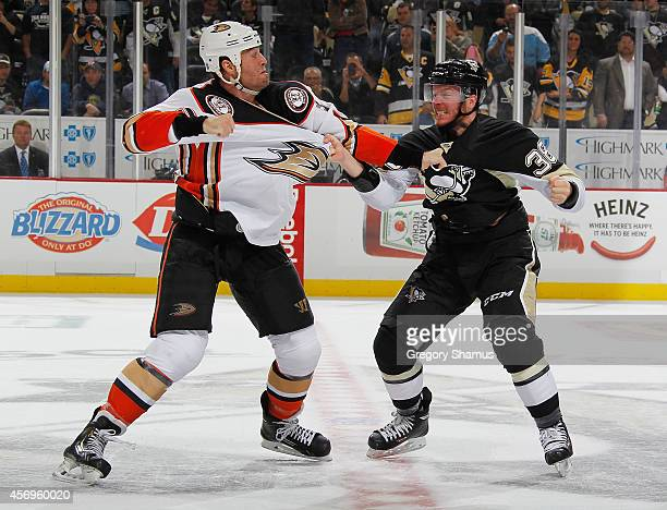 Zach Sill of the Pittsburgh Penguins and Clayton Stoner of the Anaheim Ducks fight during the third period at Consol Energy Center on October 9 2014...