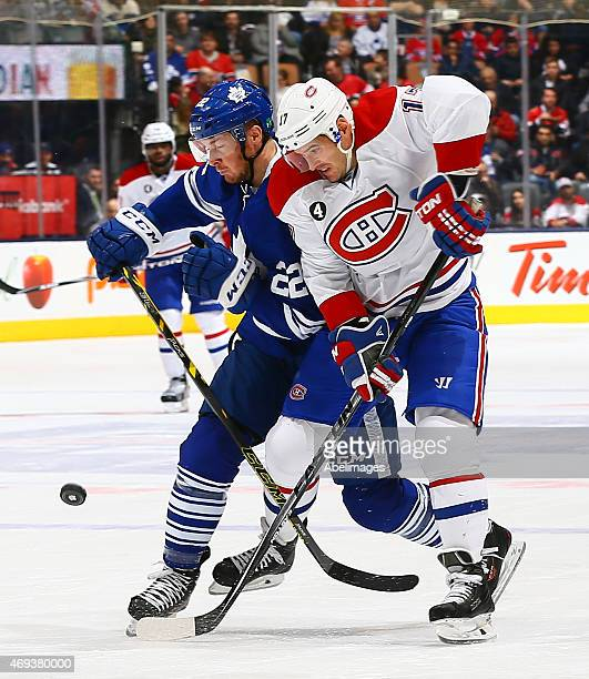 Zach Sill of the Toronto Maple Leafs runs into Torrey Mitchell of the Montreal Canadiens during NHL action at the Air Canada Centre April 11 2015 in...