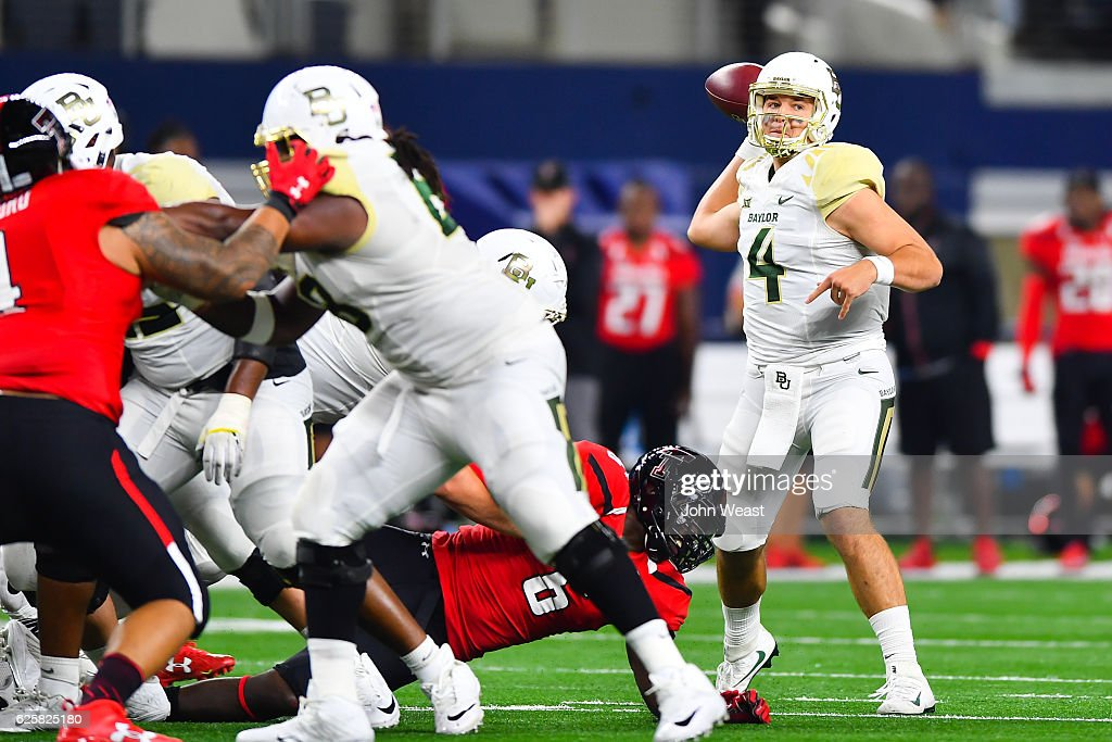 Zach Smith #4 of the Baylor Bears passes the ball during the game against the Texas Tech Red Raiders on November 25, 2016 at AT&T Stadium in Arlington, Texas. Texas Tech defeated Baylor 54-35.