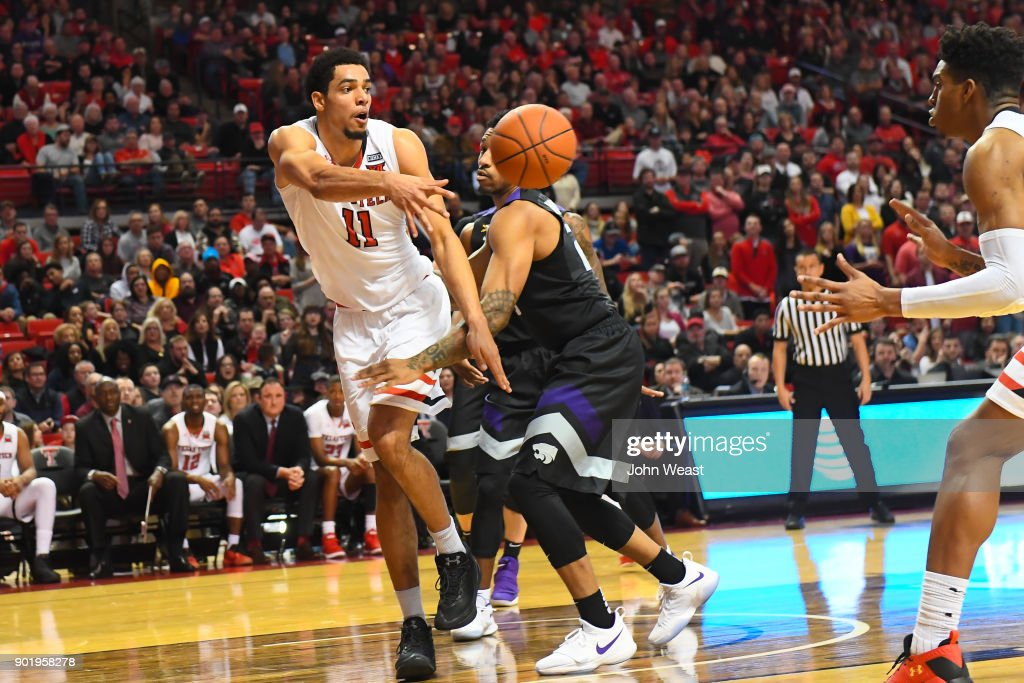 Zach Smith #11 of the Texas Tech Red Raiders passes the ball from under the basket during the game against the Kansas State Wildcats on January 6, 2018 at United Supermarket Arena in Lubbock, Texas. Texas Tech won the game 74-58.