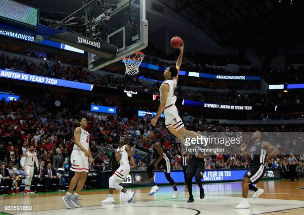 Zach Smith of the Texas Tech Red Raiders shoots against Shannon Bogues and Ty Charles of the Stephen F Austin Lumberjacks in the second half in the...
