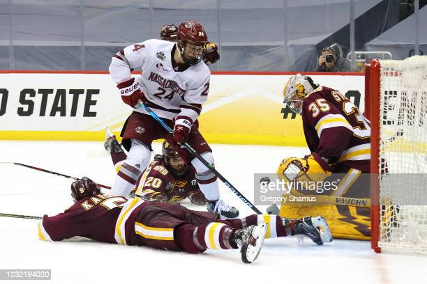 Zach Stejskal of the Minnesota Duluth Bulldogs makes a save on a shot attempt by Zac Jones of the Massachusetts Minutemen during the Division I Men's...